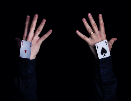 4 of a kind: two human hands with aces in sleeve