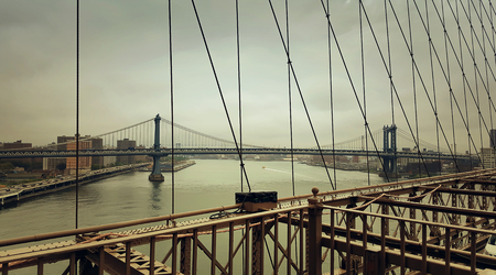 manhattan bridge: A look from Brooklyn Bridge to Manhattan Bridge over Hudson River in New York City Stock Photo