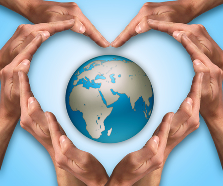 love of planet: Hands make heart shape arround the Earth globe. Love and protect our planet concept. Earth day. Safe planet