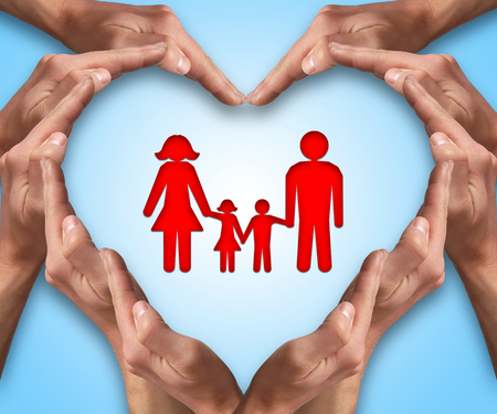 life insurance: Hands make heart shape with a family in center. Love and protection concept. Family insurance Stock Photo