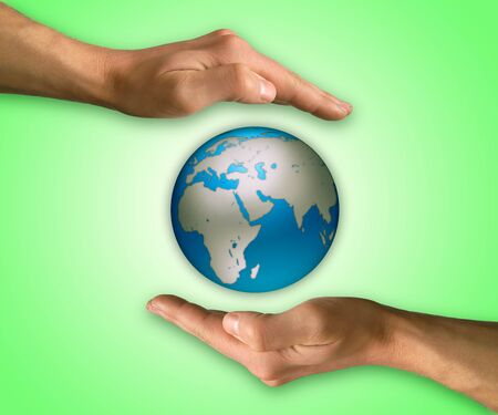 protect earth: Two hands in position to protect Earth. Protection and conservation concept