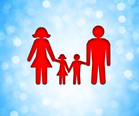 love concepts: Happy family icon over a blue bokeh background. Two children, dad and mom stand together holding hands Stock Photo