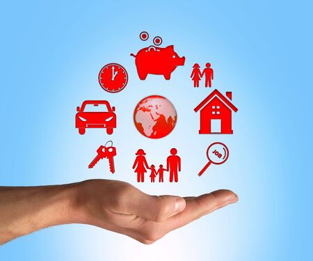 values: Opened hand make a protection gesture to life values. Family, home, money and property security. Care and insurance concept Stock Photo