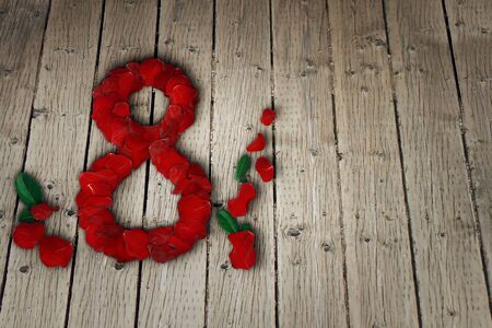 red flower: The international womens day on March, 8th. Greeting background with rose petals arranged in a shape of an eight on a wood table. Copy space