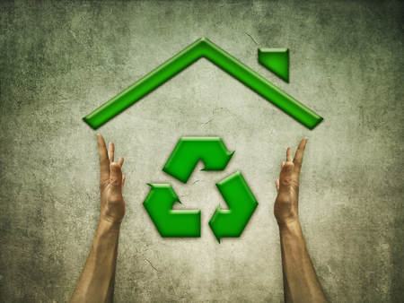 Green Eco House with recycling symbol for sustainable ecological system and renewable materials. Conceptual image about responsible building development Foto de archivo