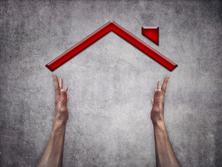 handsign: Two man hands making a house shape on gray background Stock Photo