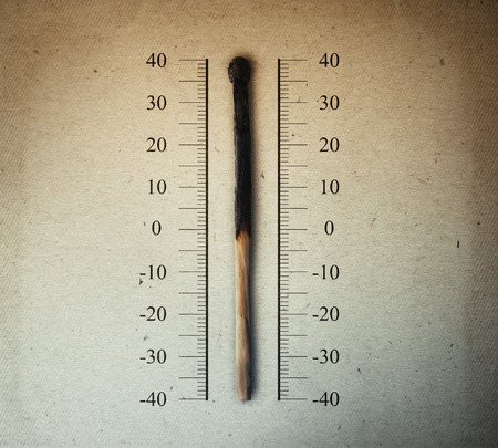 carbondioxide: Burned match indicating temperature on a scale as a thermometer. Global warming and temperature rising concept Stock Photo