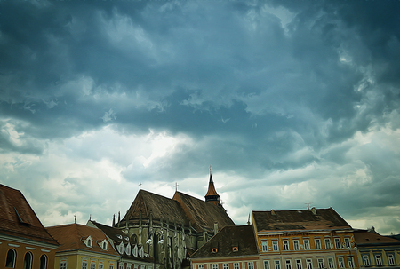 historic: Illustration of old medieval houses above a cloudy sky in the historic center of Brasov city.