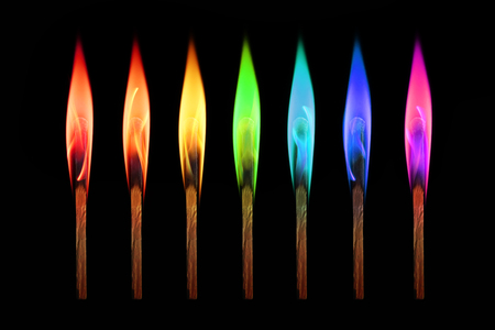 Matches burning in the rainbow colors flames on black background. Individuality concept Stock Photo