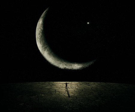 Man standing in front of a giant new moon with hands wide opened. Courage, freedom, power concept Archivio Fotografico