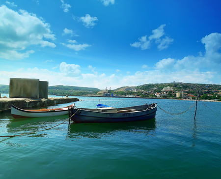 balchik: Floating boats in the sea near the pear at Balchik city, Bulgaria. Summer vacation background. Joy, happiness and recreation concept