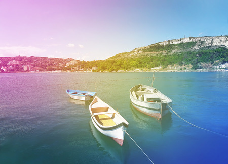 balchik: Floating boats near the pear in the Black Sea at Balchik city, Bulgaria. Summer vacation background. Joy, happiness and recreation concept Stock Photo