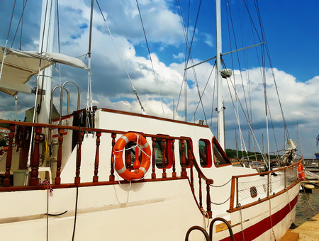 prow: Boat standing at the pier in the sea, Balchik, Bulgaria Stock Photo
