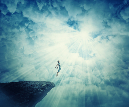 telepathy: Young boy astral travel, mystical rapture state psychokinesis condition. Magic soul energy show human illusion. Mysterious place into the clouds Stock Photo