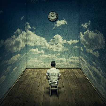 time pressure: Abstract idea with a person sitting in a dark room in front of a clock surrounded by limitations daily routine concrete walls with clouds texture. Time pressure deadline concept
