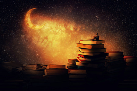 Boy sitting alone on a pile of books, looking a the new moon. Magic night scene. In search of knowlegde concept.