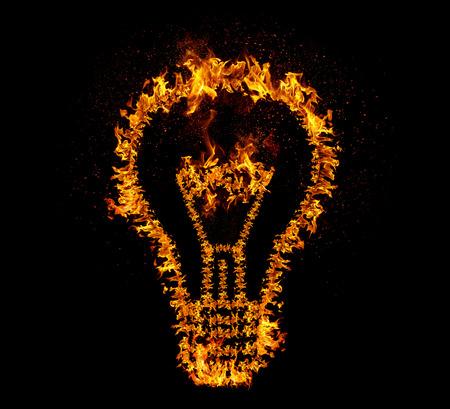 emergence: Flaming light bulb isolated on black backgeound. Emergence of the idea, Eureka creativity concept. Stock Photo
