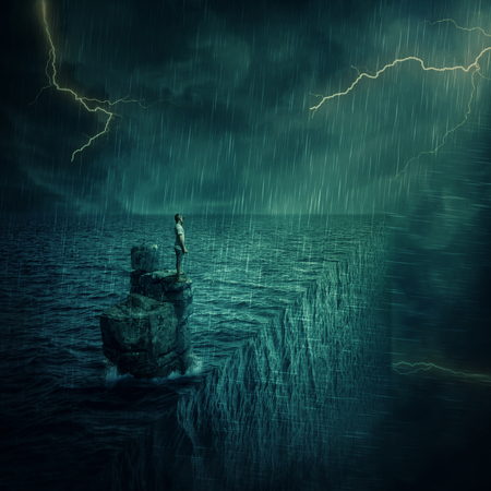 parallel world: Lost man abandoned on a rock cliff island, in the middle of the ocean, in a stormy night. Adventure and journey concept at the edge of the world. Parallel universe, multiverse theory.