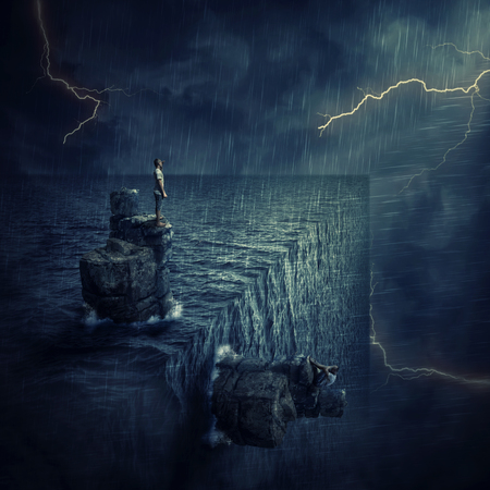 Conceptual image with a lost man sitting on a rock cliff island, in the middle of the ocean, trying to find himself in a parallel world, alternate reality. Parallel universe, multiverse fiction theory.