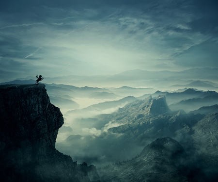 Young man riding a wild horse on the peak of a cliff. New lands discovery, adventure and friendship concept. Stockfoto