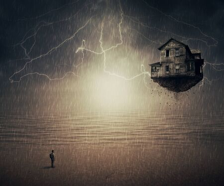 the sixth sense: Surreal backround of a man standing in the rain, in front of a flying house ripped from the ground, near the ocean. Sixth sense concept. Stock Photo