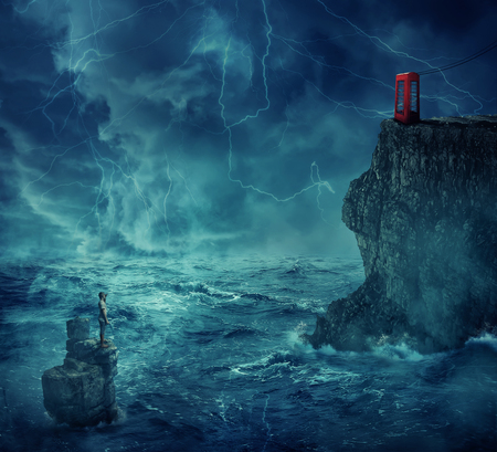 Lost man abandoned in the ocean standing on a rock island, in a stormy night with lightnings in the sky. Looking far at a cliff with a telephone box on the edge. Adventure, journey and hard determination concept.