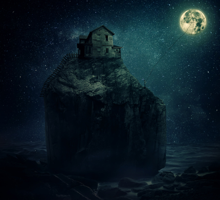 ravage: Surreal image with a wood house on the top of a rock hill, near the sea, beyond the starry night sky and a young man, holding a rope, try to catch and pull the full moon.