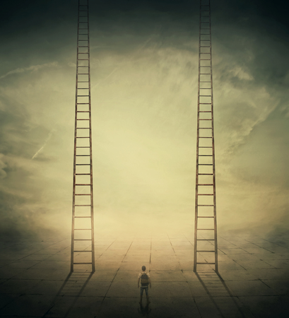 Surrealistic concept as a man standing in a foggy street looking at two stairways, thinking which to climb, choosing the correct way up. Different life opportunities, best choice for career development. Stock Photo