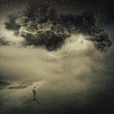 Surreal view as a young boy, stand on the sandy ground near the seaside watching a hurricane, sandstorm coming with a million fire sparkles in the sky. Adventure and life emotions. Stock Photo