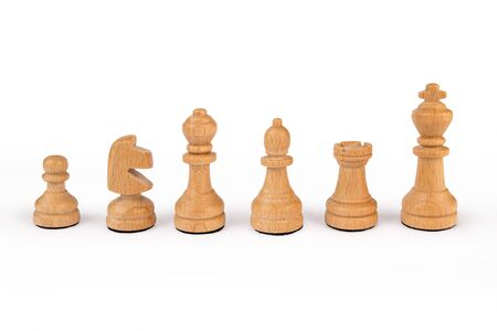 A set of standard, wooden chess pieces isolated on white background
