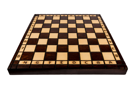 Wooden, vintage chessboard isolated on white background. Empty game table.