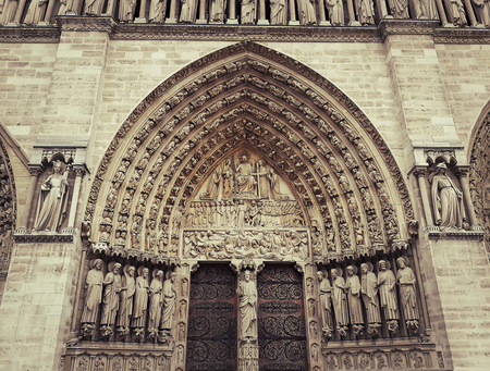 Sculpted tympanum of the Last Judgment over the entrance of the Notre-Dame de Paris.