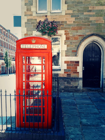 Traditional british red phone booth on the street near Guidhall, Northampton, England.