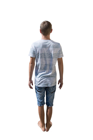Rear view full length portrait of casual young man isolated over white background.