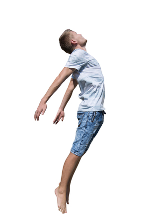 Side view full length portrait of casual young man jumping free isolated over white background. Freedom concept flying boy. Zdjęcie Seryjne