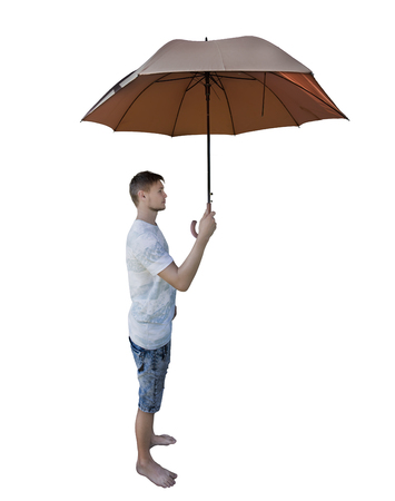Side view full length portrait of casual young man holding umbrella as protection isolated over white background.