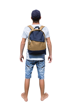 Rear view full length portrait of a curious young man traveler carrying a backpack and wearing a cap ready for adventure isolated over white background.