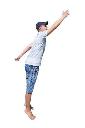 Side view full length portrait of a casual young man wearing a hat hand stretched trying to reach to something isolated over white background. Zdjęcie Seryjne