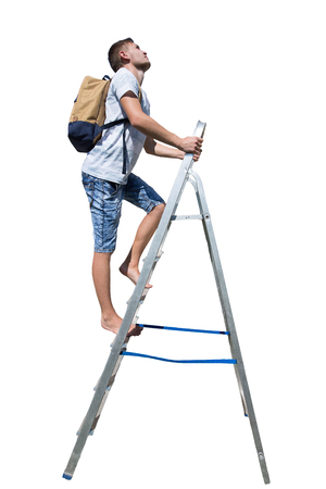 Side view full length portrait of a casual young man traveler climbing a ladder carrying a backpack looking up isolated over white background. Zdjęcie Seryjne