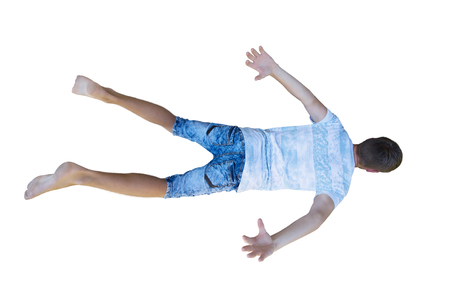 Rear view full length portrait of a young man free falling down hands and legs stretched isolated over white background. Stock Photo