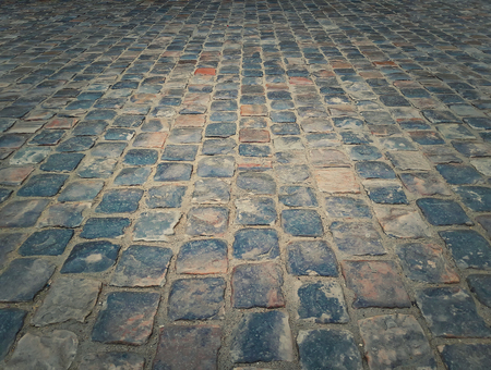Old multicolored stone vintage pavement texture. Granite cobblestoned abstract background.
