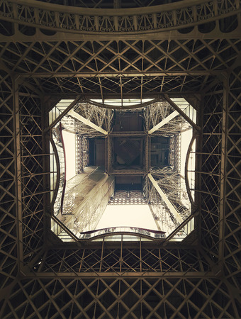 Different geometric shapes, patterns and steel structure underneath the Eiffel Tower in Paris, France.