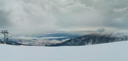 Bansko resort panoramic view with ski slope, view from the top of the mountain, Bulgaria.