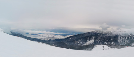 Beautiful view from the top of Pirin mountains, snowy winter morning above the clouds, Bankso, Bulgaria. Zdjęcie Seryjne