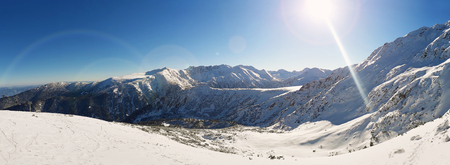Sunny winter day Panorama view from the top of snowy Pirin mountains. Zdjęcie Seryjne