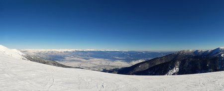 Mountains view to the winter sky slope resort from the top of Todorka peak in Bansko, Bulgaria