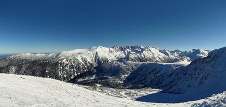 Snow covered Pirin mountains winter panorama.