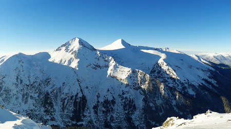 Winter panorama of Pirin mountains covered with snow in Bansko, Bulgaria.