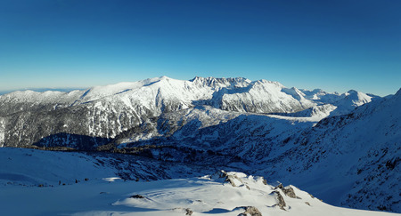 Top of High mountains, covered by snow sunny day panorama in Bansko, Bulgaria. Zdjęcie Seryjne