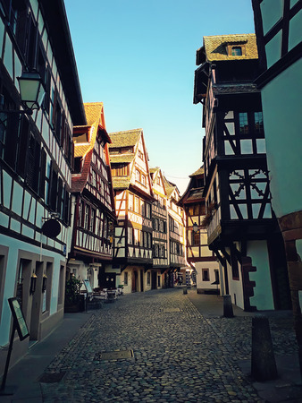 Strasbourg narrow streets of the old city with idyllic half timbered facades of medieval buildings. Beautiful architecture Petit France district, Alsace.